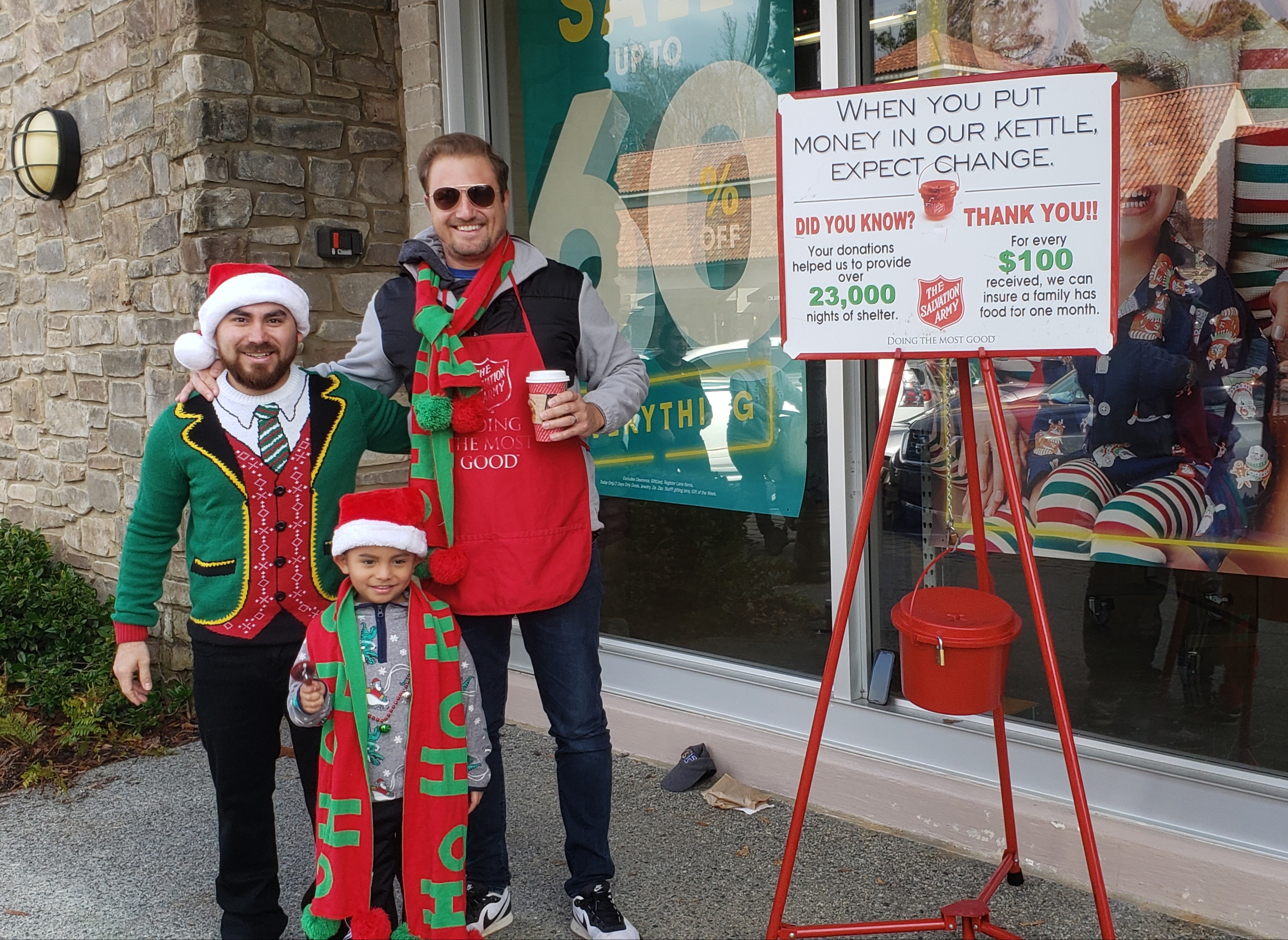 Members of our senior staff and their families ringing bells for the Salvation Army