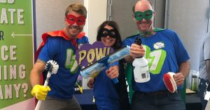 Level Seven staff dressed up as cleaning super heroes.