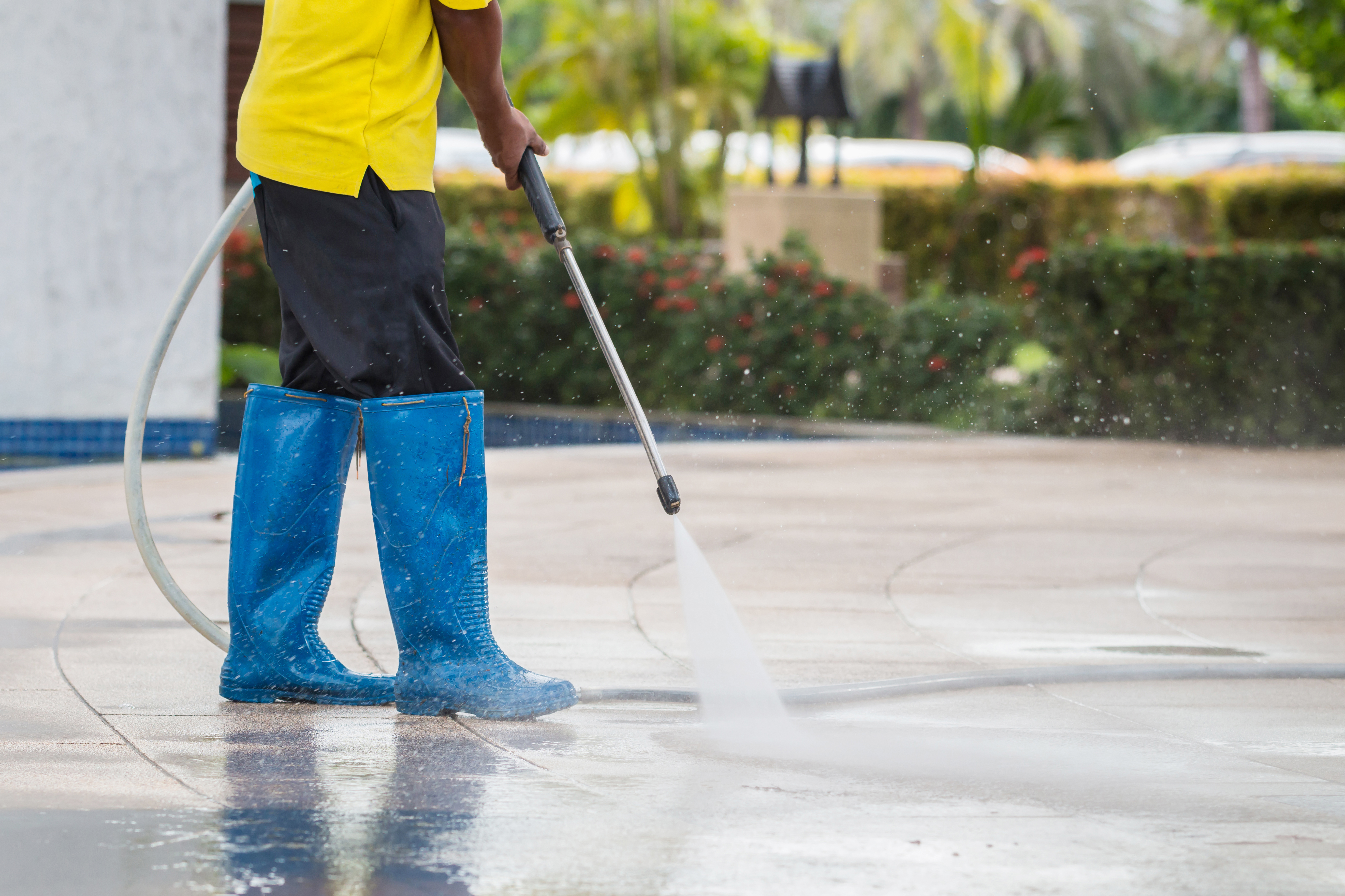 Level Seven staff member pressure washing